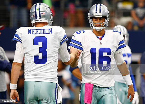 Dallas Cowboys Brandon Weeden of the Dallas Cowboys and Matt Cassel of the Dallas Cowboys fist bump before the start of their NFL game against the...