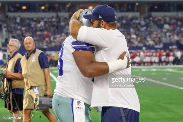 Dallas Cowboys center Travis Frederick hugs center Joe Looney prior to the preseason football game between the Dallas Cowboys and Arizona Cardinals...