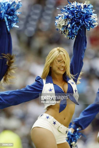 Dallas Cowboys Cheerleader performs during the NFL game against the Philadelphia Eagles at Texas Stadium on October 12 2003 in Irving Texas The...