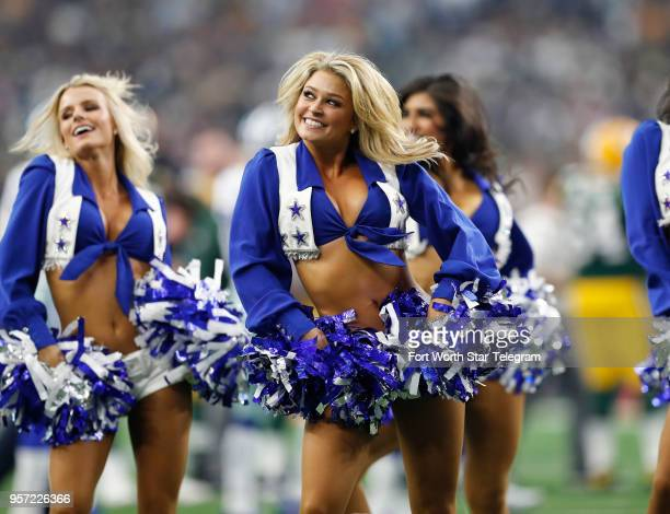 Dallas Cowboys cheerleaders perform during a game against the Green Bay Packers at ATT Stadium in Arlington Texas on October 8 2017