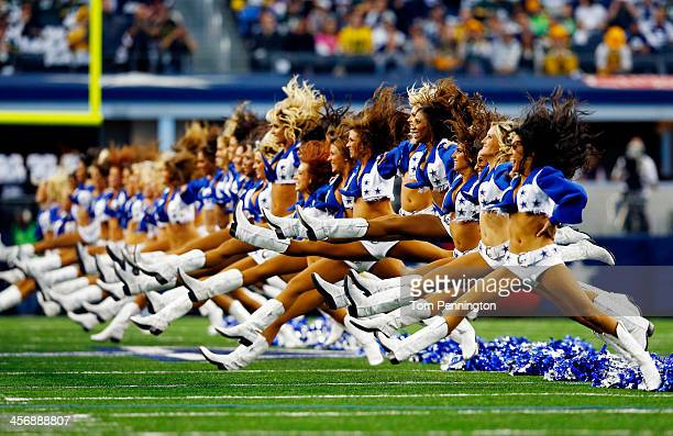 Dallas Cowboys cheerleaders perform prior to a game against the Green Bay Packers at ATT Stadium on December 15 2013 in Arlington Texas