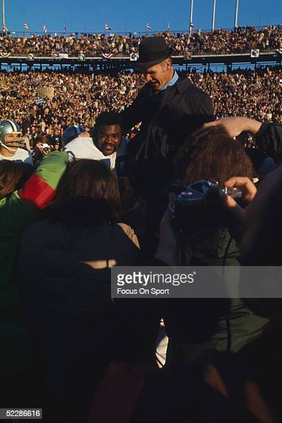 Dallas Cowboys' coach Tom Landry is carried off the field on his players' shoulders after defeating the Miami Dolphins for Super Bowl VI at Tulane...