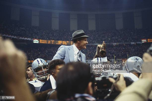 Dallas Cowboys coach Tom Landry is lifted on the shoulders of his team and is carried across the field after defeating the Denver Broncos at...