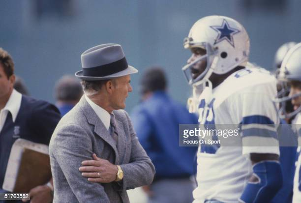 Dallas Cowboys' coach Tom Landry talk to a player Tom Landry directed the Dallas Cowboys to 20 consecutive winning seasons from 196685 and two Super...