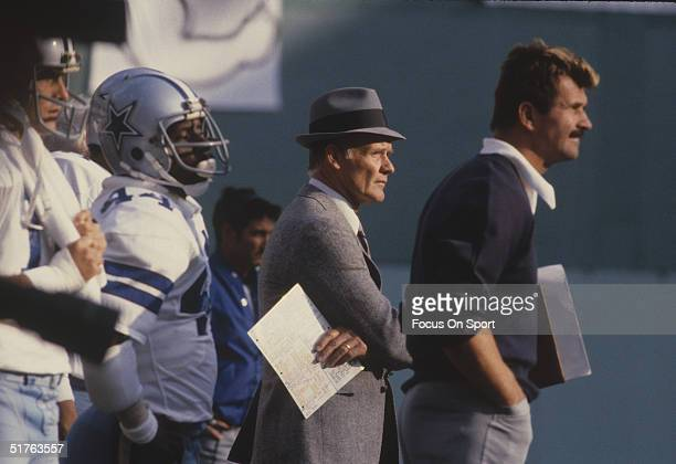 Dallas Cowboys' coach Tom Landry watches the action on the field Tom Landry directed the Dallas Cowboys to 20 consecutive winning seasons from 196685...