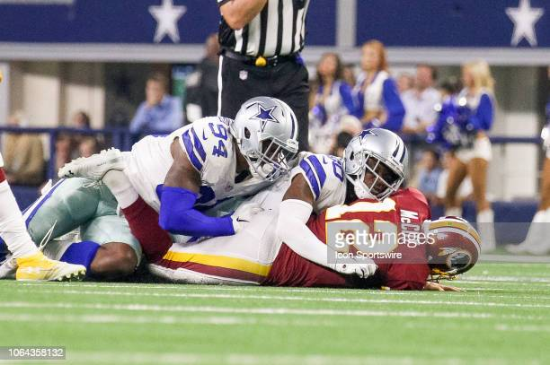 Dallas Cowboys Cornerback Anthony Brown and Defensive End Randy Gregory sack Washington Redskins Quarterback Colt McCoy during the Thanksgiving Day...
