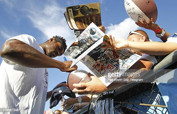 Dallas Cowboys cornerback Brandon Carr signs autographs before the Hall of Fame Game against the Miami Dolphins at Fawcett Stadium in Canton Ohio...