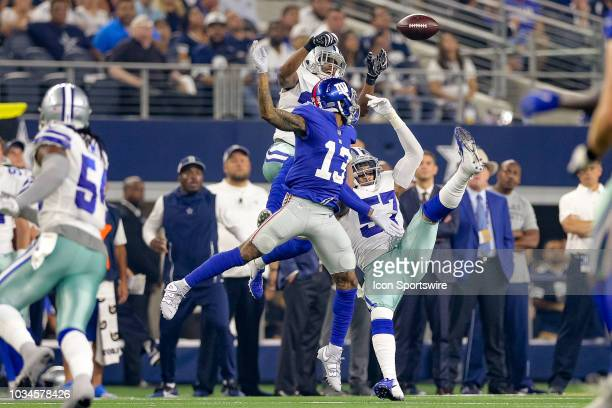 Dallas Cowboys cornerback Byron Jones and linebacker Damien Wilson break up a pass intended for New York Giants wide receiver Odell Beckham during...