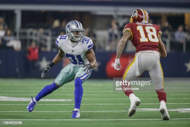 Dallas Cowboys cornerback Byron Jones and Washington Redskins wide receiver Josh Doctson battle for position during the game between the Dallas...
