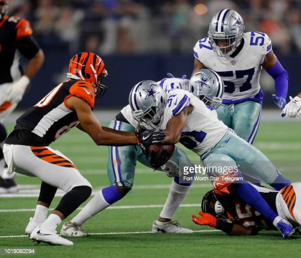 Dallas Cowboys cornerback Byron Jones comes up with the Cincinnati Bengals fumble on Saturday Aug 18 2018 at ATT Stadium in Arlington Texas