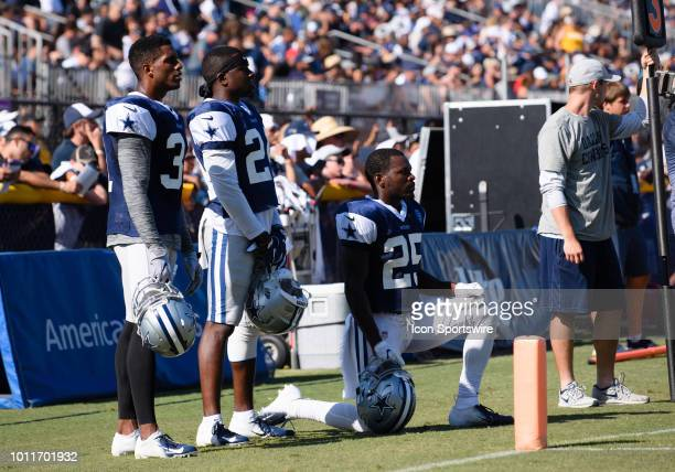 Dallas Cowboys cornerback Byron Jones , Dallas Cowboys cornerback Chidobe Awuzie and Dallas Cowboys defensive back Xavier Woods sit on the sidelines...