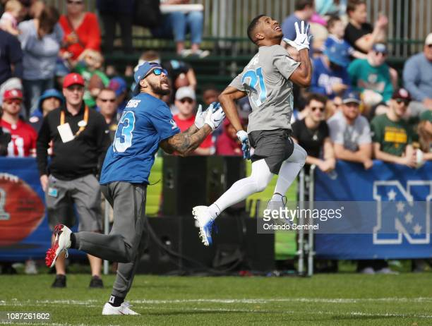 NFC Dallas Cowboys cornerback Byron Jones leaps over NFC Tampa Bay Buccaneers receiver Mike Evans during NFL Pro Bowl practice at ESPN Wide World of...