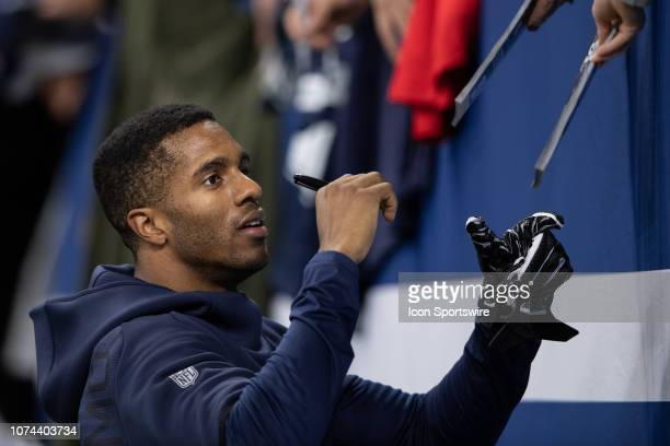 Dallas Cowboys cornerback Byron Jones signs autographs before the NFL game between the Indianapolis Colts and Dallas Cowboys on December 16 at Lucas...