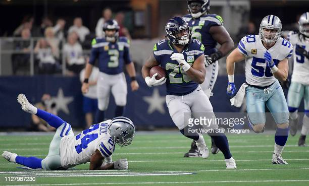 Dallas Cowboys cornerback Chidobe Awuzie and linebacker Sean Lee can't make the stop as Seattle Seahawks running back Rashaad Penny picks up a first...