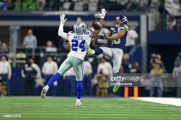 Dallas Cowboys cornerback Chidobe Awuzie breaks up a pass intended for Seattle Seahawks wide receiver Tyler Lockett during the NFC wildcard playoff...