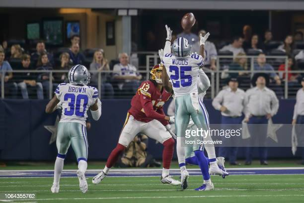 Dallas Cowboys cornerback Chidobe Awuzie tips a pass in front of Washington Redskins wide receiver Maurice Harris and Dallas Cowboys free safety...