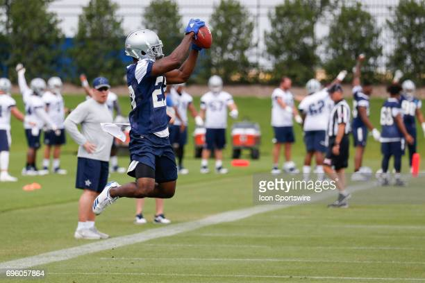 Dallas Cowboys Cornerback Leon McFadden leaps to catch a ball during Dallas Cowboys minicamp on June 14, 2017 at The Star in Frisco, TX.