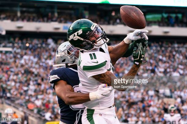 Dallas Cowboys Cornerbacker Byron Jones breaks up a pass intended for New York Jets Wide Receiver Robby Anderson during the first half of the game...