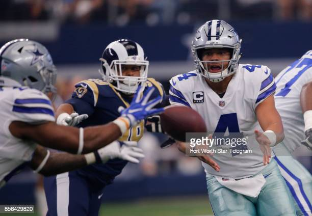 Dallas Cowboys' Dak Prescott pitches the ball to Ezekiel Elliott on a first half play against the Los Angeles Rams on Sunday Oct 1 2017 at ATT...