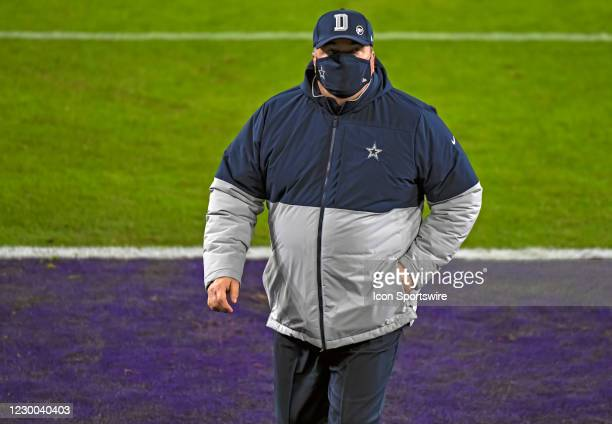 Dallas Cowboys Dallas Head Coach Mike McCarthy walks off the field after warm ups for the Dallas Cowboys game versus the Baltimore Ravens on December...