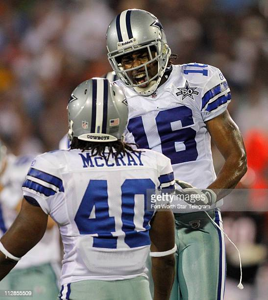 Dallas Cowboys' Danny McCray and Jesse Holley celebrate after tackling Cincinnati Bengals' Jordan Shipley for a loss of one yard on a punt in the...