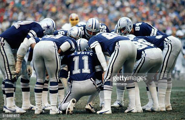 Dallas Cowboys' Danny White in huddle calling signals during National Football Conference Championship against the Washington Redskins