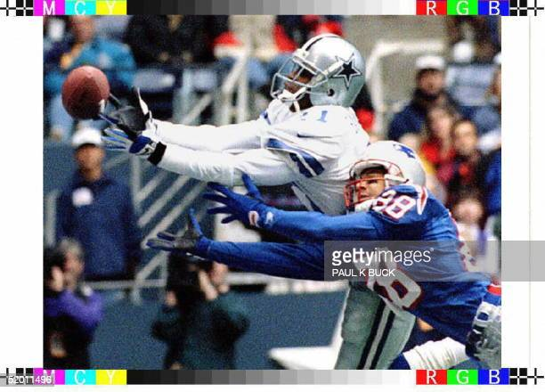 Dallas Cowboys defensive back Deion Sanders breaks up a pass intended for New England Patriots receiver Terry Glenn during first half action in their...