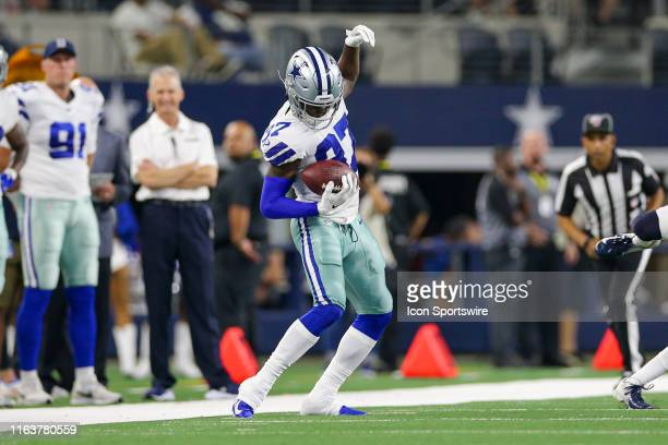 Dallas Cowboys defensive back Donovan Wilson keeps both feet in bounds after intercepting a pass during the preseason game between the Houston Texans...