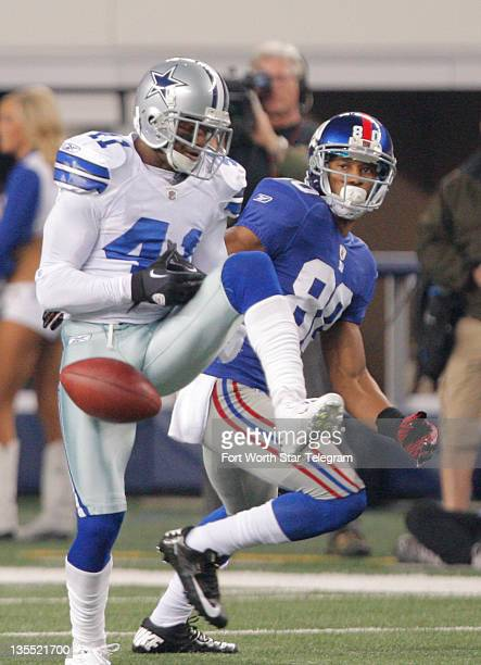Dallas Cowboys defensive back Terence Newman steps in front of an Eli Manning pass intended for New York Giants wide receiver Victor Cruz . Newman...