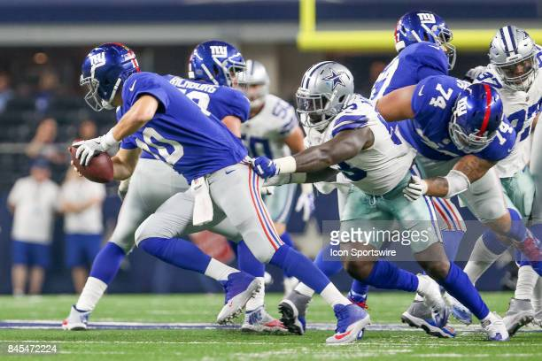 Dallas Cowboys defensive end Benson Mayowa is held by New York Giants offensive tackle Ereck Flowers while pressuring quarterback Eli Manning during...