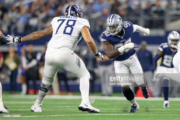 Dallas Cowboys defensive end Demarcus Lawrence rushes against Tennessee Titans offensive tackle Jack Conklin during the game between the Tennessee...