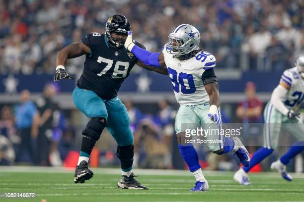 Dallas Cowboys defensive end Demarcus Lawrence rushes the edge around Jacksonville Jaguars offensive tackle Jermey Parnell during the game between...