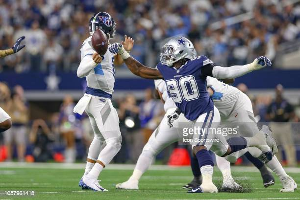Dallas Cowboys defensive end Demarcus Lawrence strips the ball away from Tennessee Titans quarterback Marcus Mariota during the game between the...