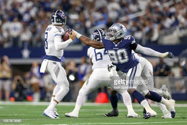 Dallas Cowboys defensive end Demarcus Lawrence strips the ball from Tennessee Titans quarterback Marcus Mariota during the game between the Tennessee...