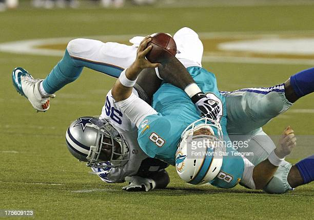 Dallas Cowboys defensive end George Selvie sacks Miami Dolphins quarterback Matt Moore for a nine yard loss in the second quarter of the Hall of Fame...