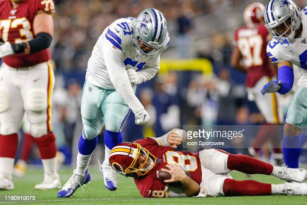 Dallas Cowboys Defensive End Kerry Hyder celebrates his sack of Washington Redskins Quarterback Case Keenum during the NFC East game between the...