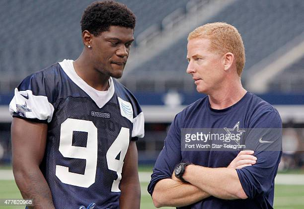 Dallas Cowboys defensive end Randy Gregory and head coach Jason Garrett talk after practice in Arlington Texas on Thursday June 18 2015