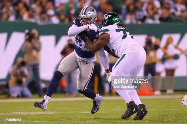 Dallas Cowboys defensive end Robert Quinn battles New York Jets offensive tackle Brandon Shell during the National Football League game between the...