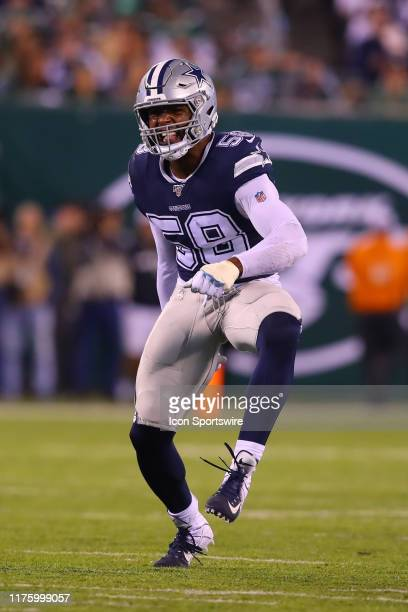Dallas Cowboys defensive end Robert Quinn celebrates after a sack during the National Football League game between the New York Jets and the Dallas...