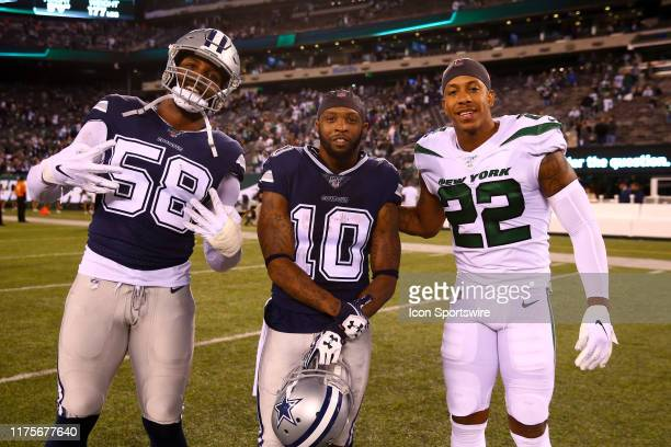 Dallas Cowboys defensive end Robert Quinn Dallas Cowboys wide receiver Tavon Austin and New York Jets cornerback Trumaine Johnson pose for a photo...