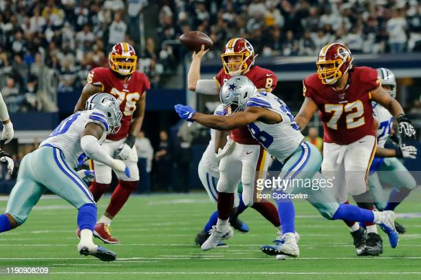 Dallas Cowboys defensive end Robert Quinn hits Washington Redskins quarterback Case Keenum as he releases the football during the game between the...