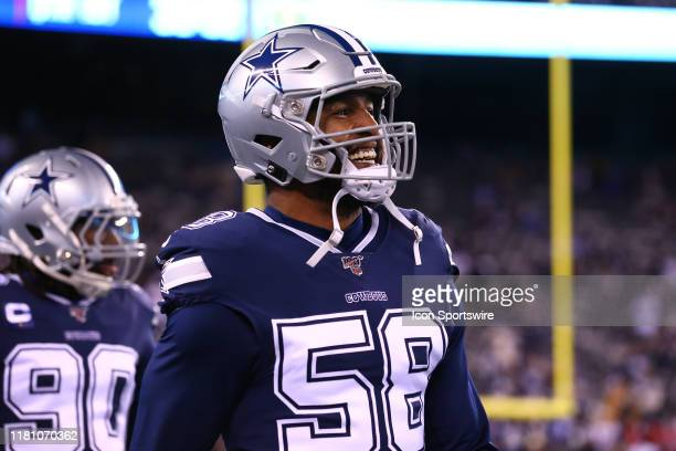 Dallas Cowboys defensive end Robert Quinn on the field prior to the National Football League game between the New York Giants and the Dallas Cowboys...