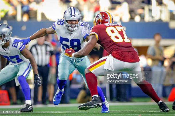 Dallas Cowboys Defensive End Robert Quinn rushes against Washington Redskins Tight End Jeremy Sprinkle during the NFC East game between the Dallas...