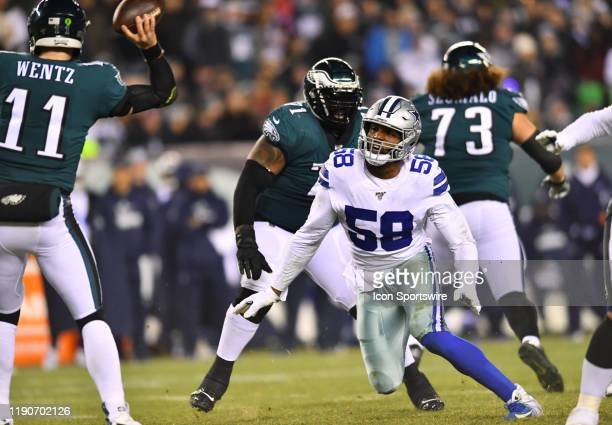 Dallas Cowboys Defensive End Robert Quinn rushes Philadelphia Eagles Quarterback Carson Wentz in the second half during the game between the Dallas...