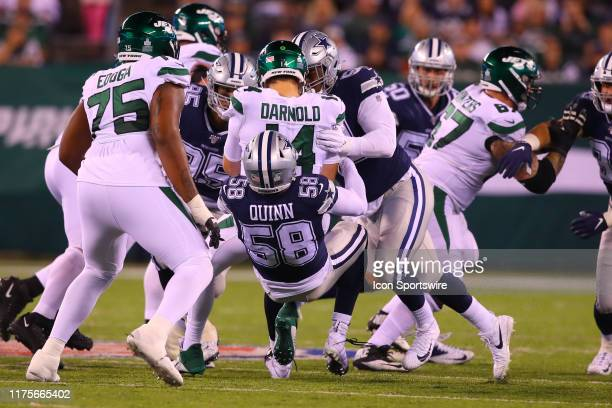 Dallas Cowboys defensive end Robert Quinn sacks New York Jets quarterback Sam Darnold during the National Football League game between the New York...