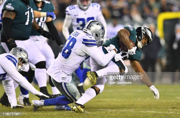 Dallas Cowboys Defensive End Robert Quinn tackles Philadelphia Eagles Running Back Boston Scott on a carry in the second half during the game between...
