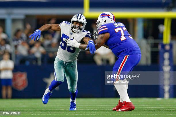 Dallas Cowboys Defensive End Robert Quinn works to rush around Buffalo Bills Offensive Tackle Dion Dawkins during the game between the Buffalo Bills...