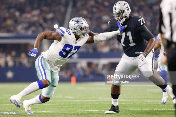 Dallas Cowboys defensive end Taco Charlton battles Oakland Raiders offensive tackle David Sharpe during the NFL preseason game between the Oakland...