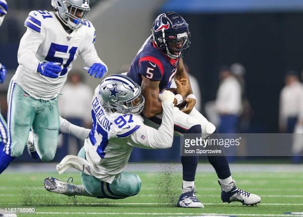 Dallas Cowboys defensive end Taco Charlton hits Houston Texans quarterback Joe Webb during the preseason game between the Houston Texans and Dallas...