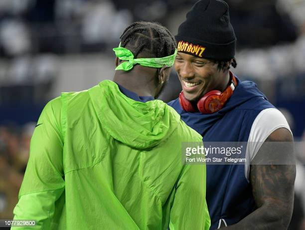 Dallas Cowboys defensive end Taco Charlton right talks to Seattle Seahawks defensive end Frank Clark before the start of action in a NFL Wild Card...